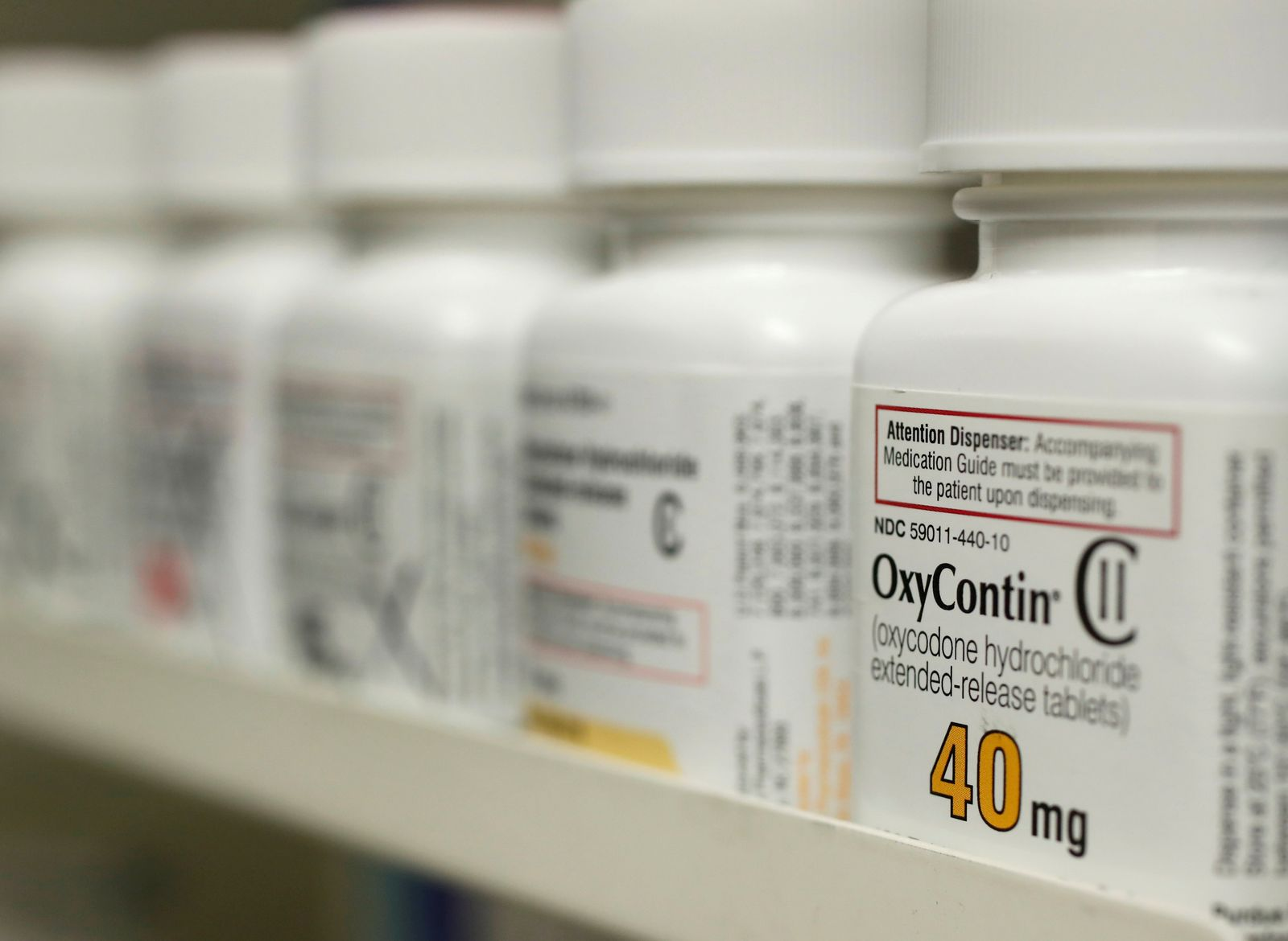 FILE PHOTO: FILE PHOTO: Bottles of prescription painkiller OxyContin, 40mg pills, made by Purdue Pharma L.D. sit on a shelf at a local pharmacy in Provo
