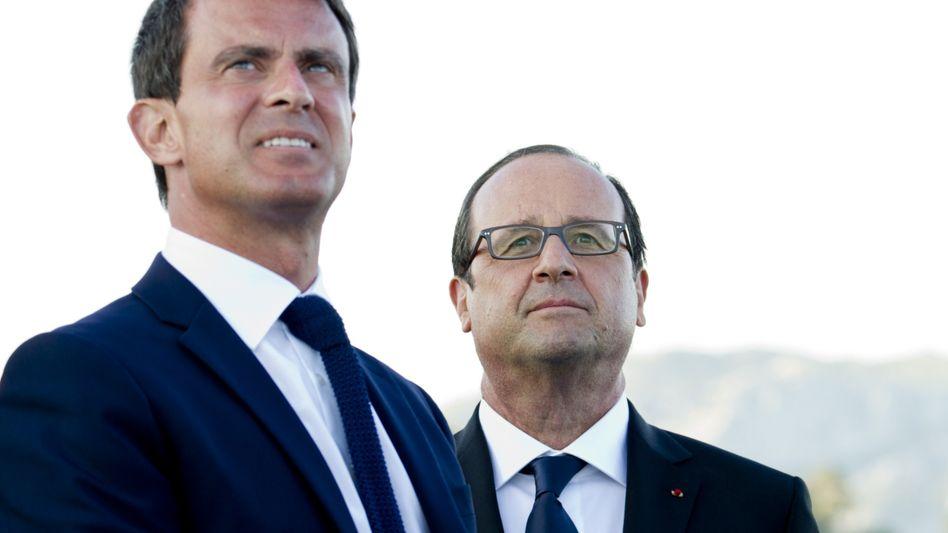 Valls (l., mit Hollande): Am Dienstag soll der Ministerpräsident eine neue Regierung vorstellen
