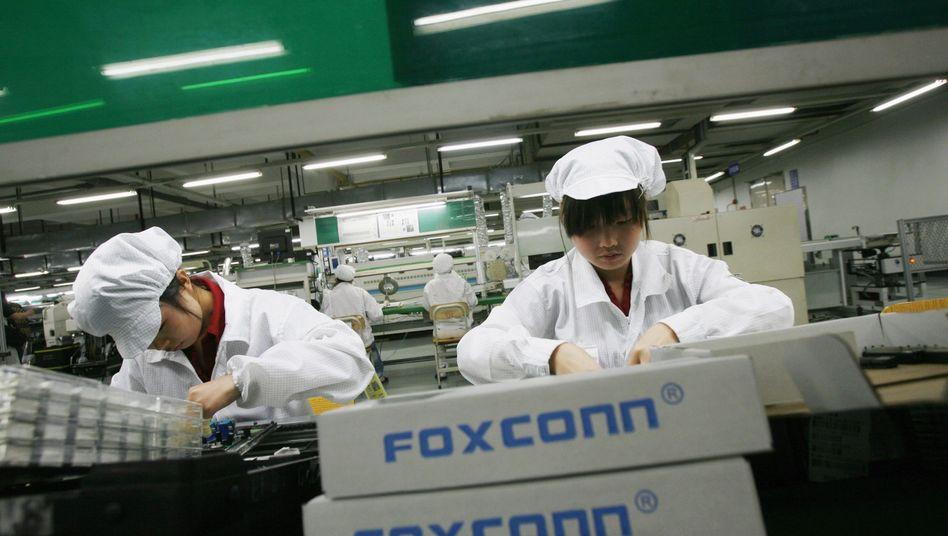 Arbeiter bei Foxconn: Arbeitsbedingungen fördern offenbar Streiks