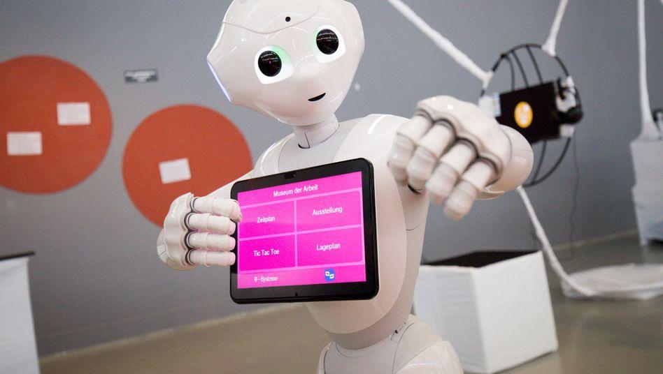 """Roboter """"Pepper"""": Merkel fordert eine Reform des EU-Beihilfe- und Wettbewerbsrechts sowie eine neue Industriepolitik, um technologisch und bei KI aufzuholen"""