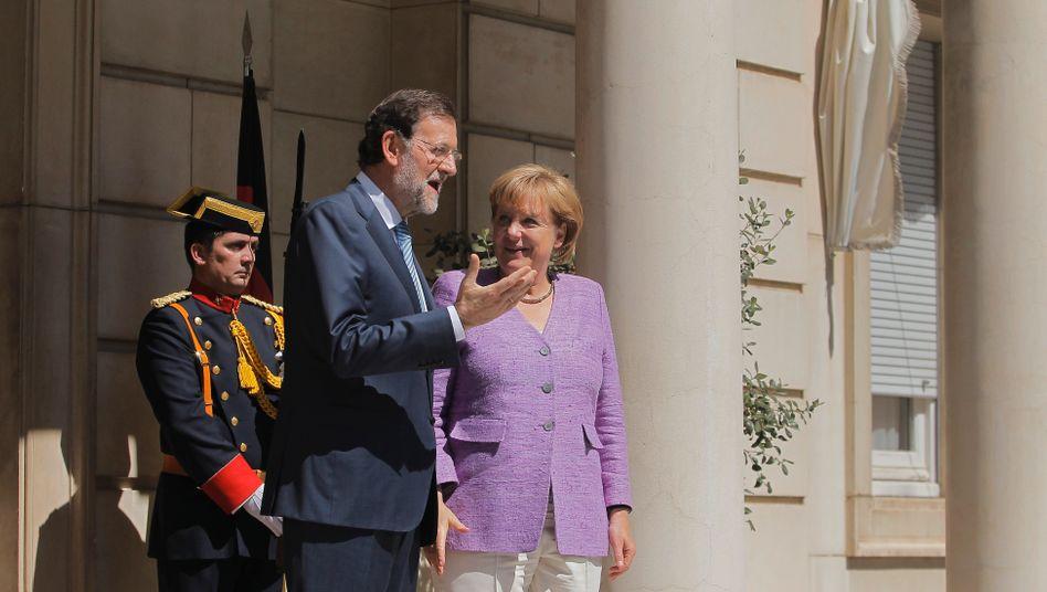 Spaniens Premier Mariano Rajoy und Kanzlerin Angela Merkel: Krisengespräche in rascher Folge