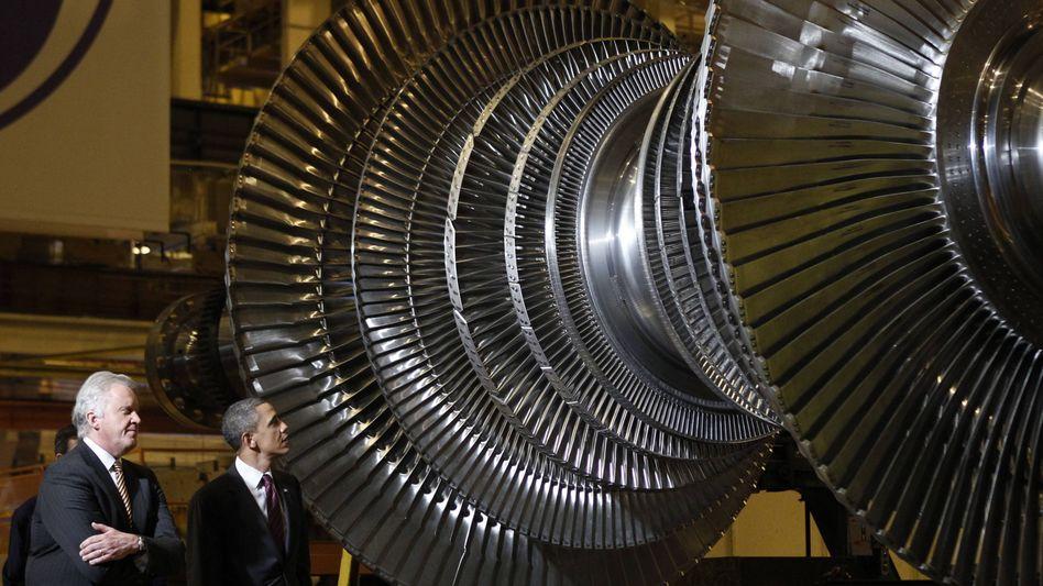 General Electric: Auch das Flagschiff von Corporate America (im Bild GE-Chef Jeff Immelt mit Barack Obama) konnte nicht überzeugen
