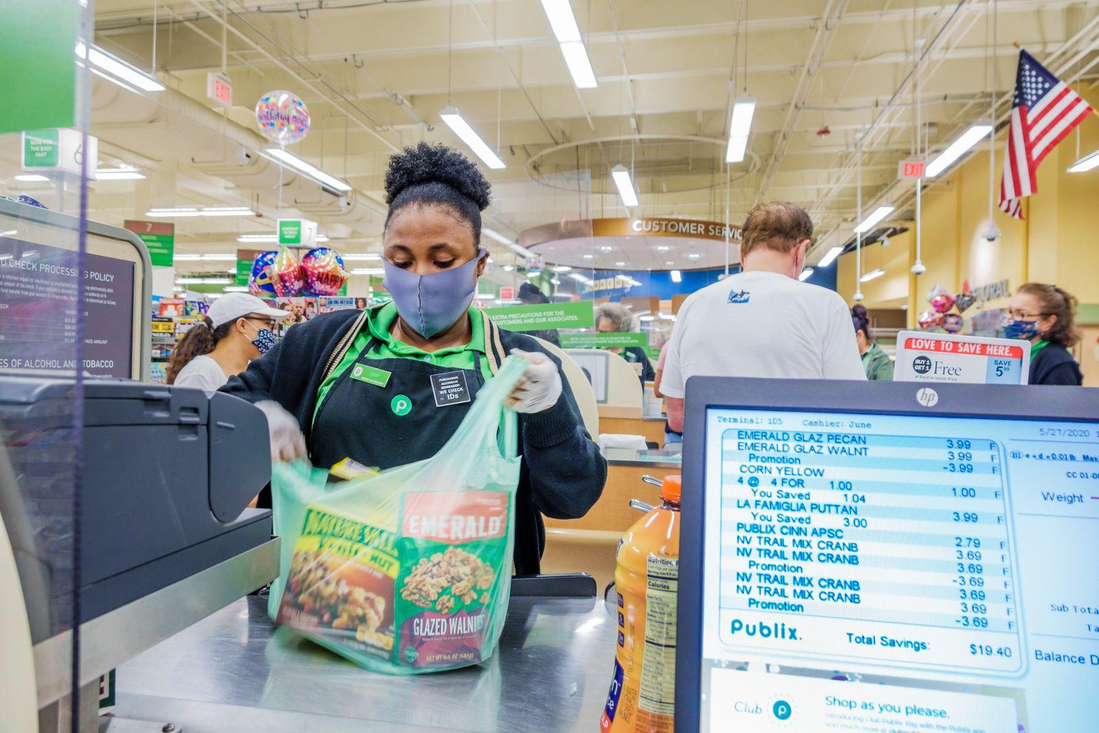 Florida, Miami Beach, Publix, supermarket check out cashier during Coronavirus Pandemic