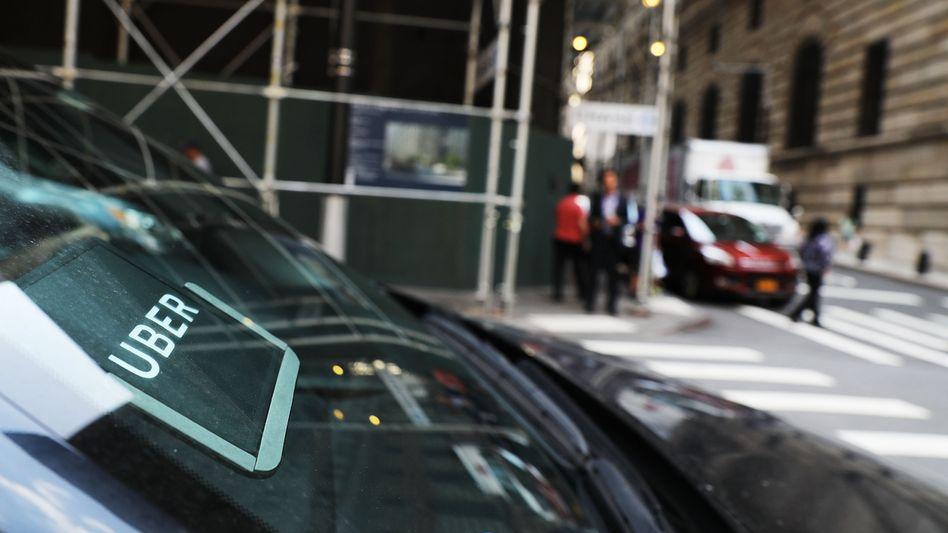 Uber-Fahrzeug in den Straßen von New York: Der Beförderungsdienst setzte viel Geld für die Einführung der Maut in Manhattan ein.