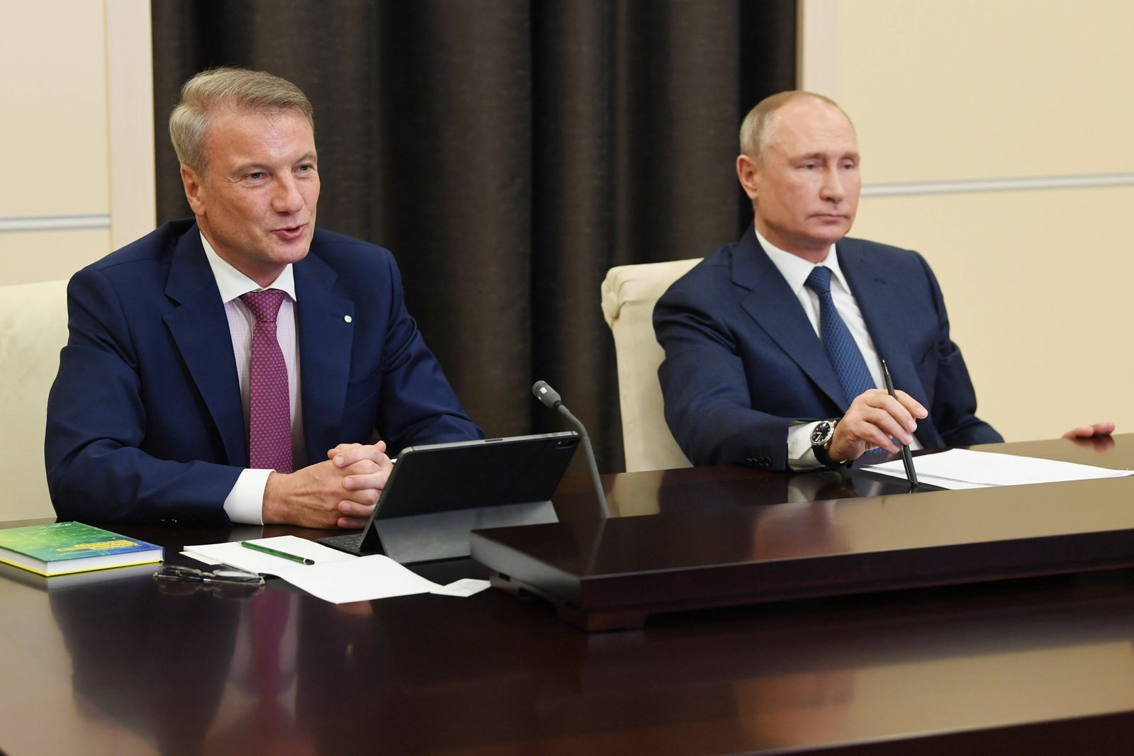 MOSCOW REGION, RUSSIA - DECEMBER 4, 2020: Sberbank CEO Herman Gref (L) and Russia s President Vladimir Putin are seen in