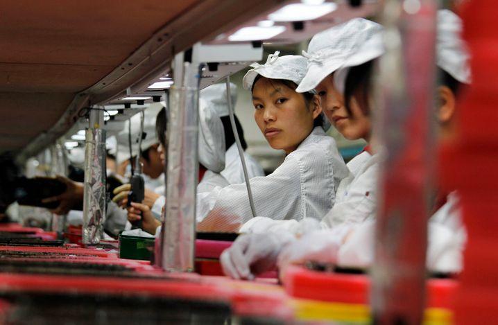 Foxconn-Fabrik in Südchina: Die Arbeiter zählen Millionen, die Roboter noch nicht