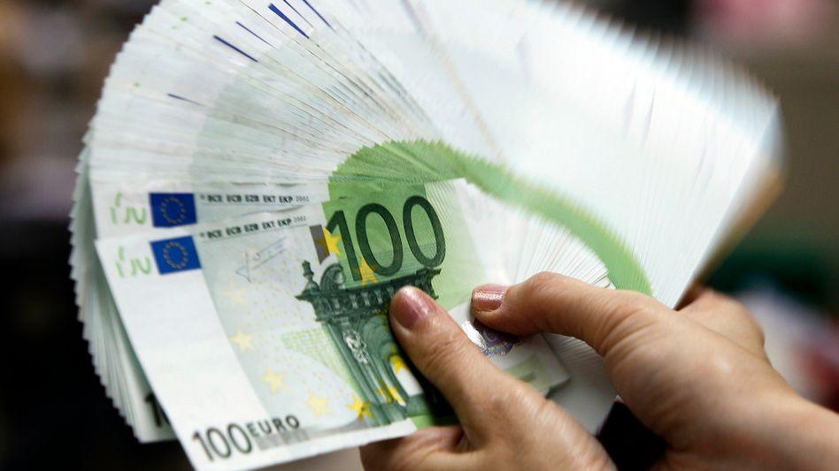 Mehr Geld in der Hand des Fiskus: Der Staat wird bis 2016 vermutlich bis zu 100 Milliarden Euro mehr einnehmen