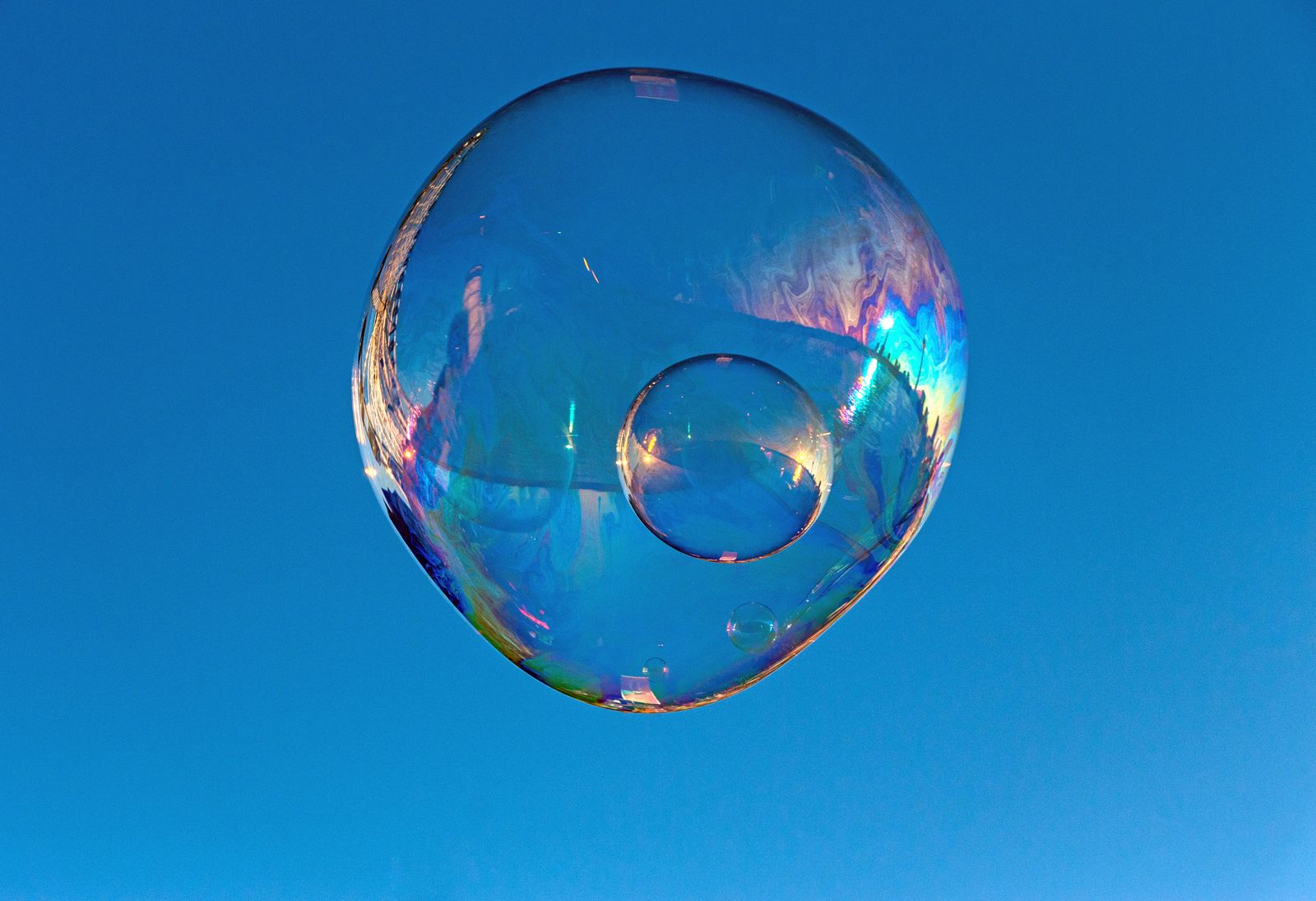 Close-Up Of Soap Bubble Against Clear Blue Sky