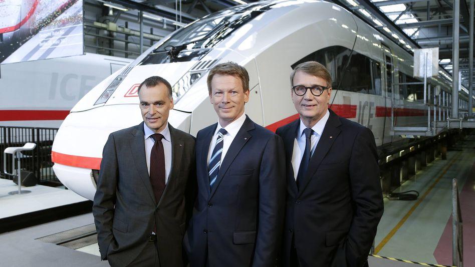 Massiv steigende Verluste: Die Verträge von Bahnchef Richard Lutz (Mitte) Berthold Huber (l.) und Ronald Pofalla werden dennoch verlängert