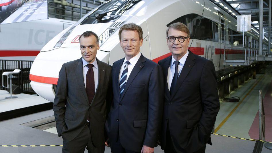 Massiv steigende Verluste: Die Verträge von Bahnchef Richard Lutz (Mitte) Berthold Huber (l.) und Ronald Pofalla wurden dennoch verlängert. Sie sollen weiterarbeiten - vorerst fürs gleiche Geld.
