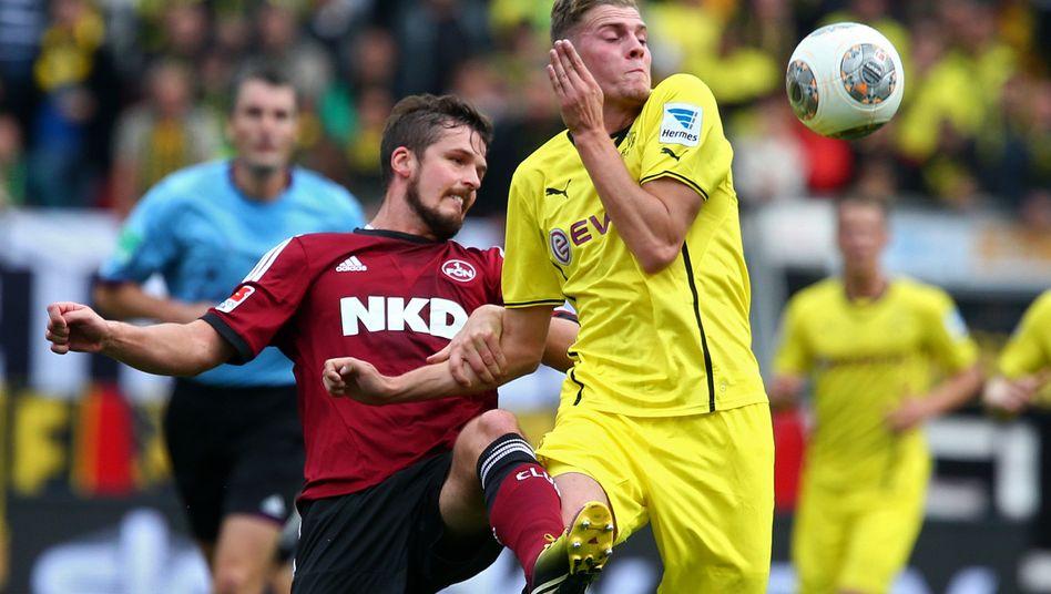 Sportlich und wirtschaftlich erfolgreich: Der BVB hat an diesem Wochenende in Nürnberg zwar nur ein Remis geholt, die Schwarz-Gelben führen aber weiter die Tabelle an