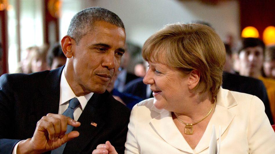 Barack Obama, Angela Merkel: Der US-Präsident hat eine Reindustrialisierung nach deutschem Vorbild angestoßen