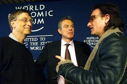 Prominente Gäste auf dem WEF 2005: Microsoft-Chef Bill Gates, Englands Premier Tony Blair und U2-Sänger Bono
