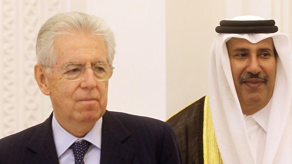 Ein gutes Geschäft? Italiens Premierminister Mario Monti (l.) und sein katarischer Amtskollege Scheich Hamad bin Jassem bin Jabr al-Thani