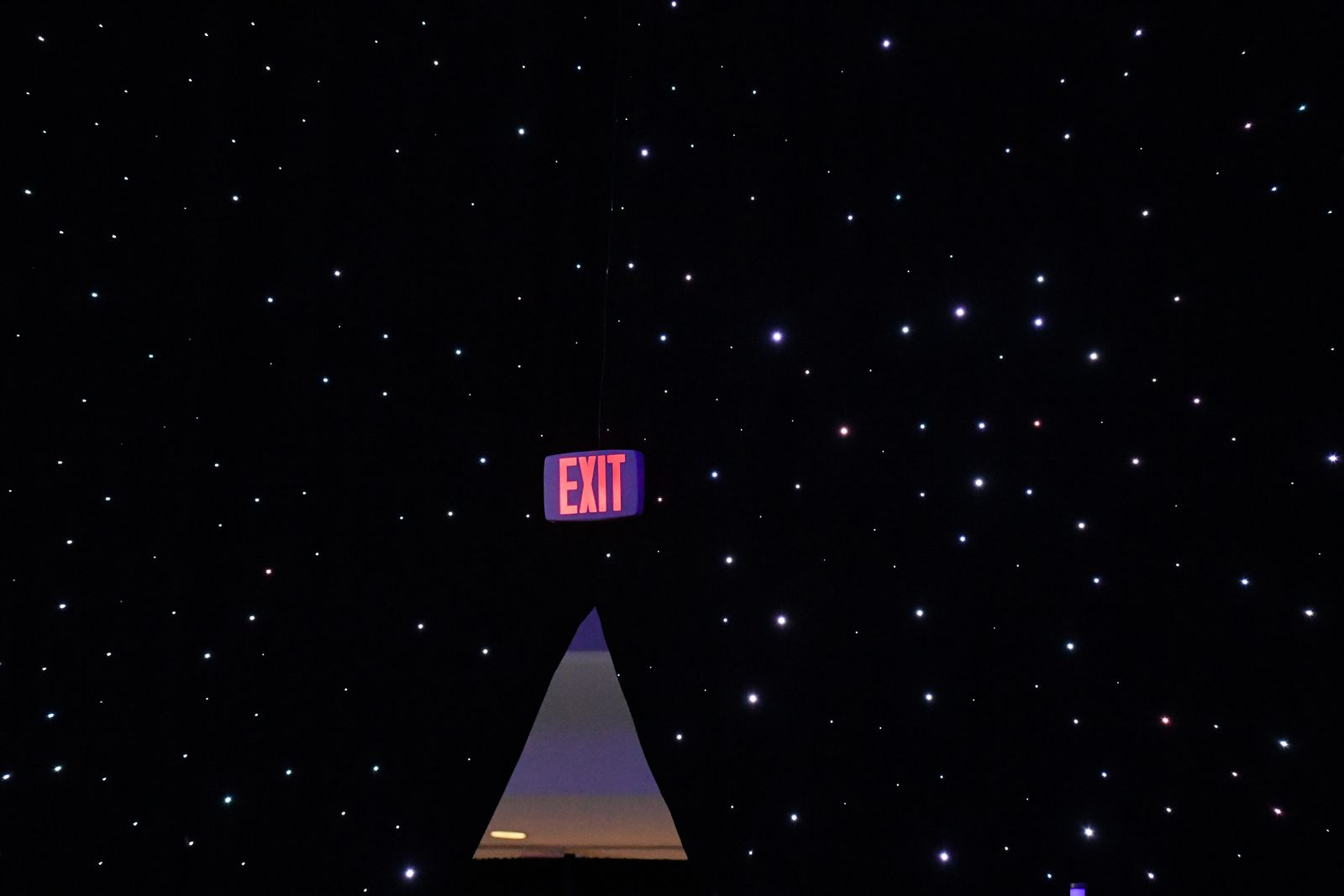 An exit sign is seen as founder, Chairman, CEO and President of Amazon Jeff Bezos unveils his space company Blue Origin's space exploration lunar lander rocket called Blue Moon during an unveiling event in Washington