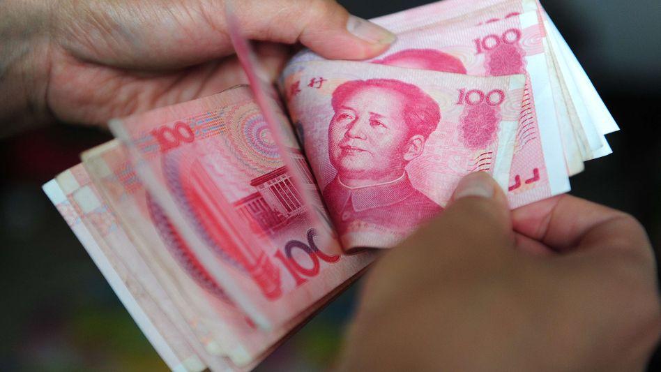 Riesige Bargeldbestände: Im Vergleich zu 2005 sind fast 80 Prozent mehr Yuan im Umlauf