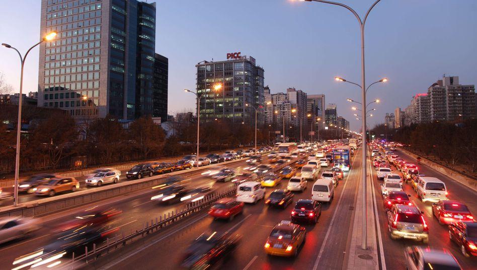 Rush hour in Peking: Alibaba, Softbank und Tencent wollen einen Durchmarsch Ubers in China verhindern