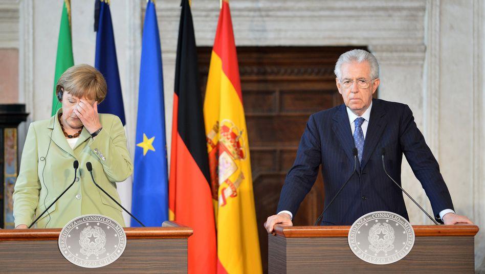 Bundeskanzlerin Merkel und Italiens Ministerpräsident Monti wollen den Euro retten, aber auf unterschiedliche Art und Weise