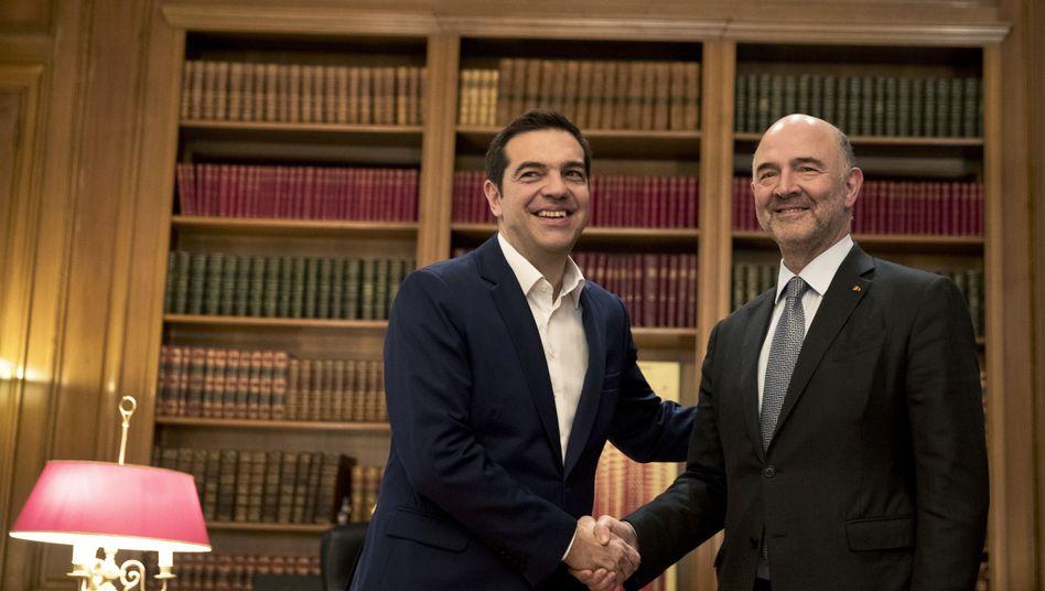 Griechenlands Premier Alexis Tsipras, EU Währungskommissar Pierre Moscovici: Griechenland will sich bald wieder selbst finanzieren