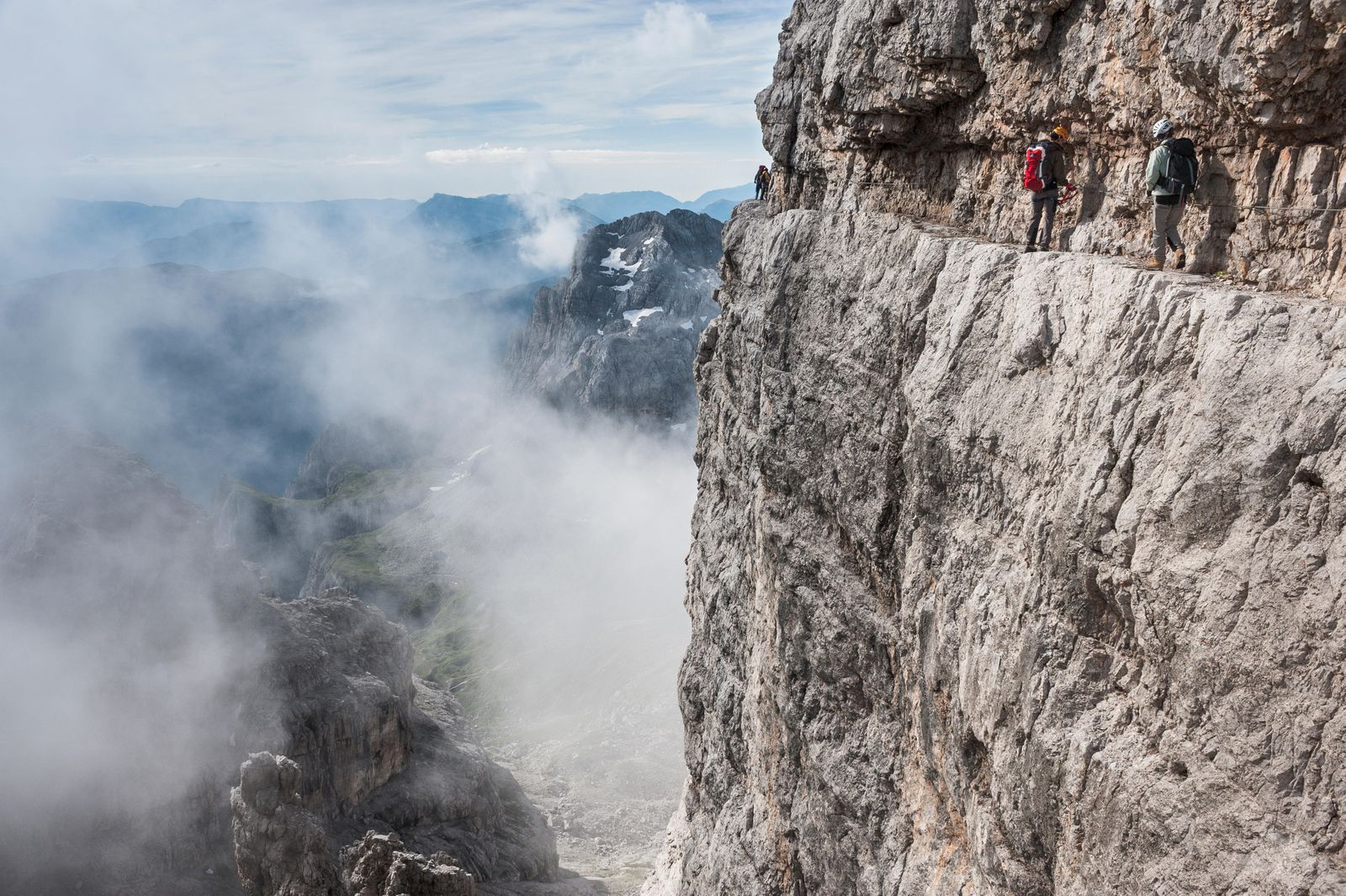 Climbers on rock band, via ferrata Bocchette Centrali, no. 305, Adamello-Brenta nature park, Brenta group, Dolomites, Trentino