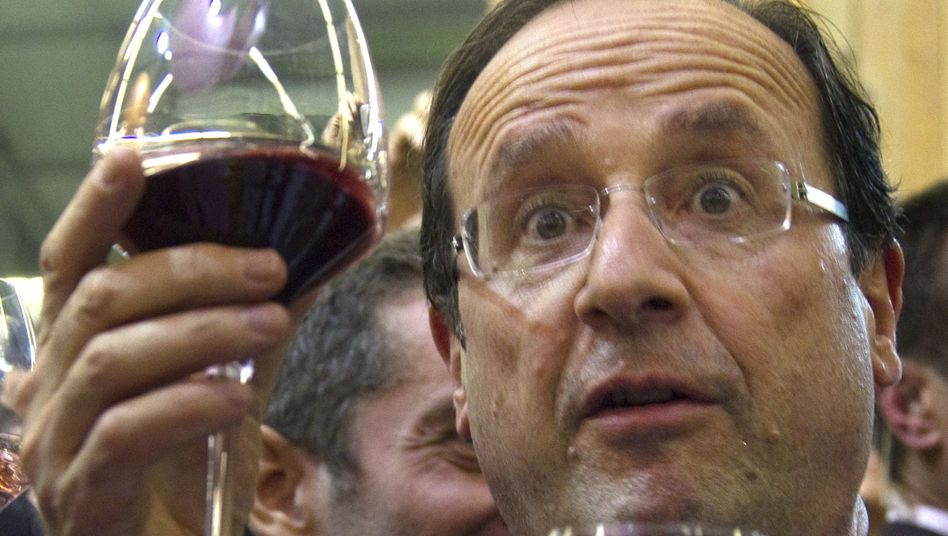 Keine leeren Gläser: Frankreichs Präsident François Hollande besitzt ein teures Haus und dazu zwei Wohnungen an der Cote