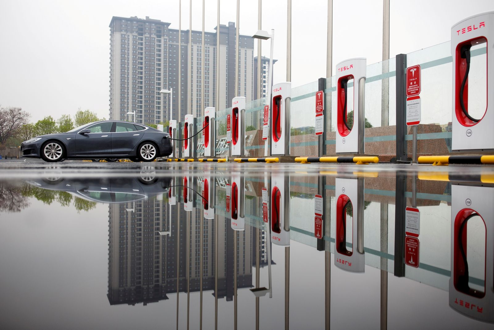 FILE PHOTO: A Tesla car pictured at a charging point in Beijing