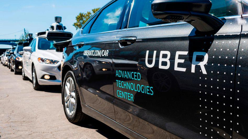 Uber-Autos in Pittburgh, USA: Der Fahrvermittler will an die Börse - zu einer utopisch erscheinenden Bewertung.