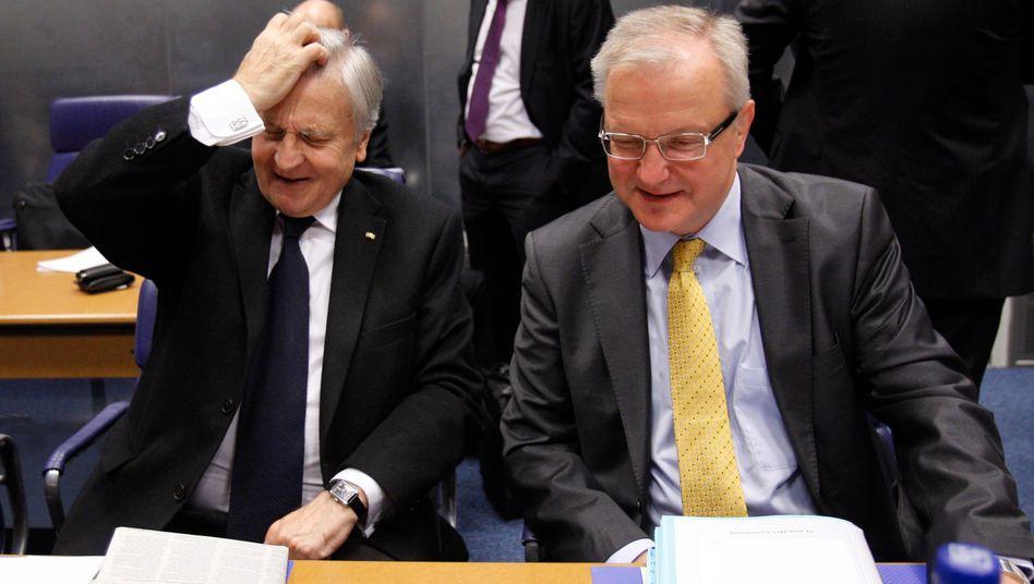 Gespannte Lage: EZB-Chef Jean-Claude Trichet, Währungskommissar Olli Rehn (rechts)