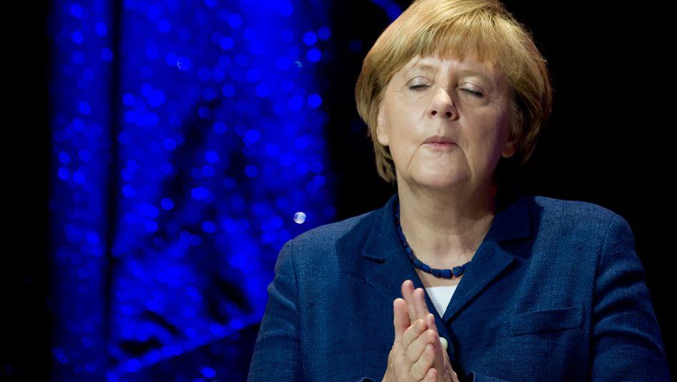 Bundeskanzlerin Angela Merkel: Körpersprache, vom Fotografen gebannt
