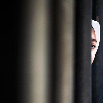 Nie das Gesicht verlieren: Junge Muslimin in Kuala Lumpur