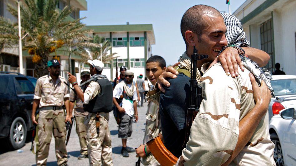 Freude in Tripolis: Die Planung für den Wiederaufbau beginnt