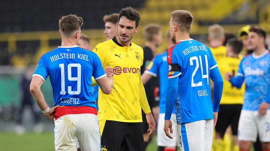 Abpfiff: Dortmunds Mats Hummels (M.) mit Co-Investoren Simon Lorenz und Hauke Wahl