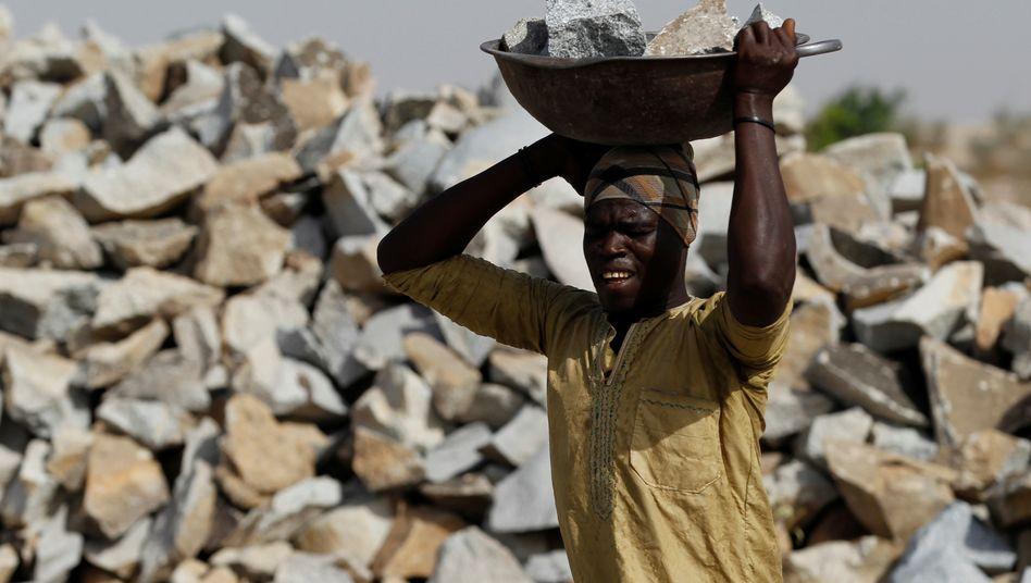 Goldminen-Arbeiter: Beteiligungen an Rohstoffvorkommen sind extrem spekulativ - und haben manchen Anleger viel Geld gekostet