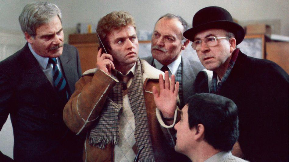 """""""Was wollen Sie? Drei Millionen in Bitcoin?"""" So überrascht wie diese Herren im letzten Edgar-Wallace-Film """"Die Schokoladenschnüffler"""" (1985) sind viele Topmanager, wenn Hacker plötzlich Lösegeld fordern."""
