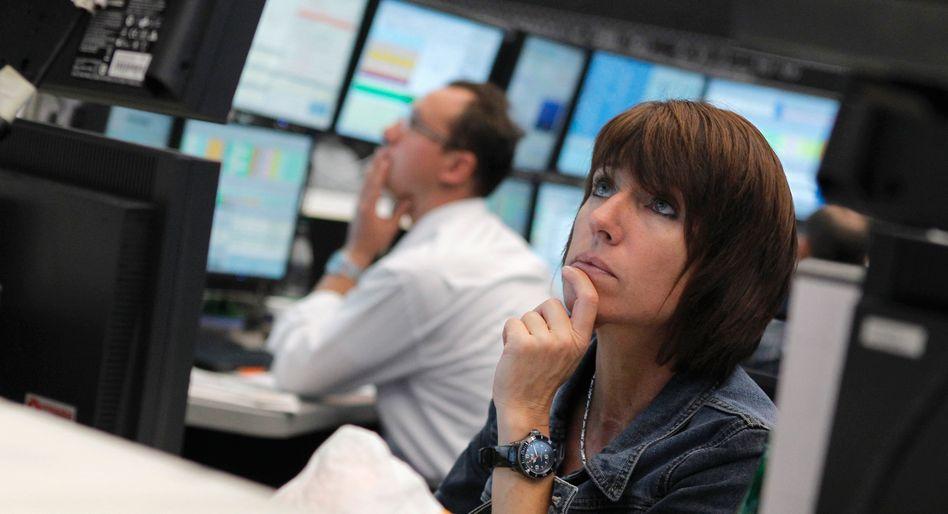 Börse in Frankfurt: Der Dax verliert, hält sich aber zunächst über der Marke von 10.000 Zählern