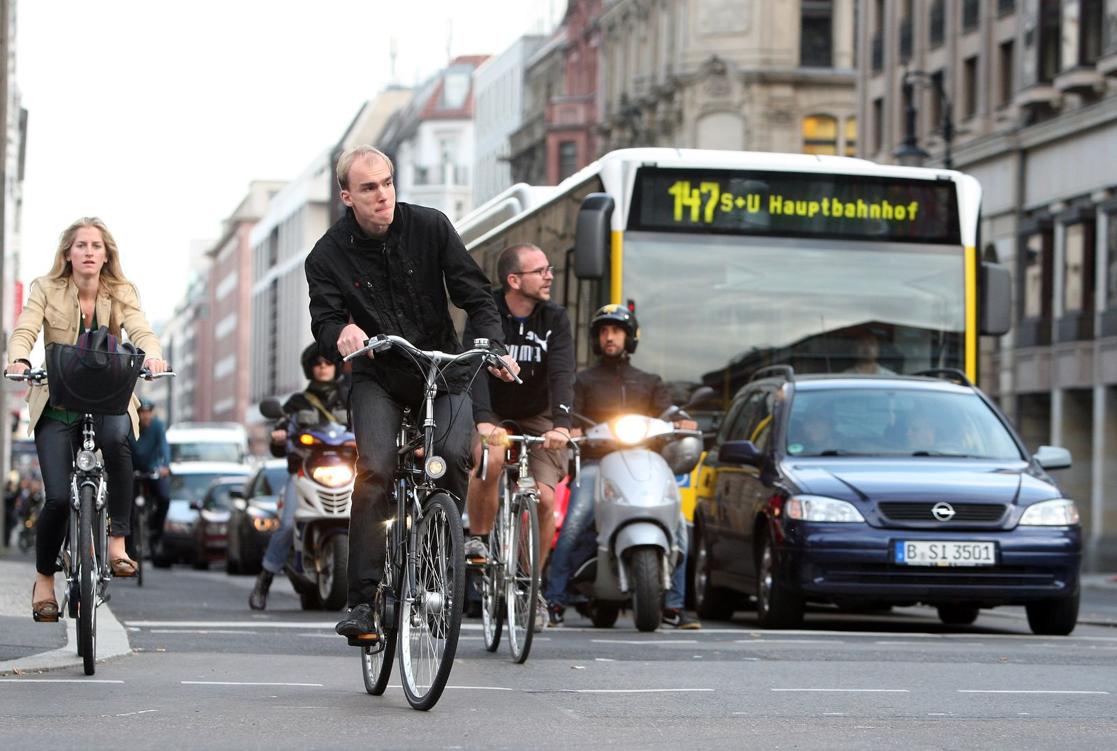 Motorists And Cyclists Co-Exist In Urban Traffic