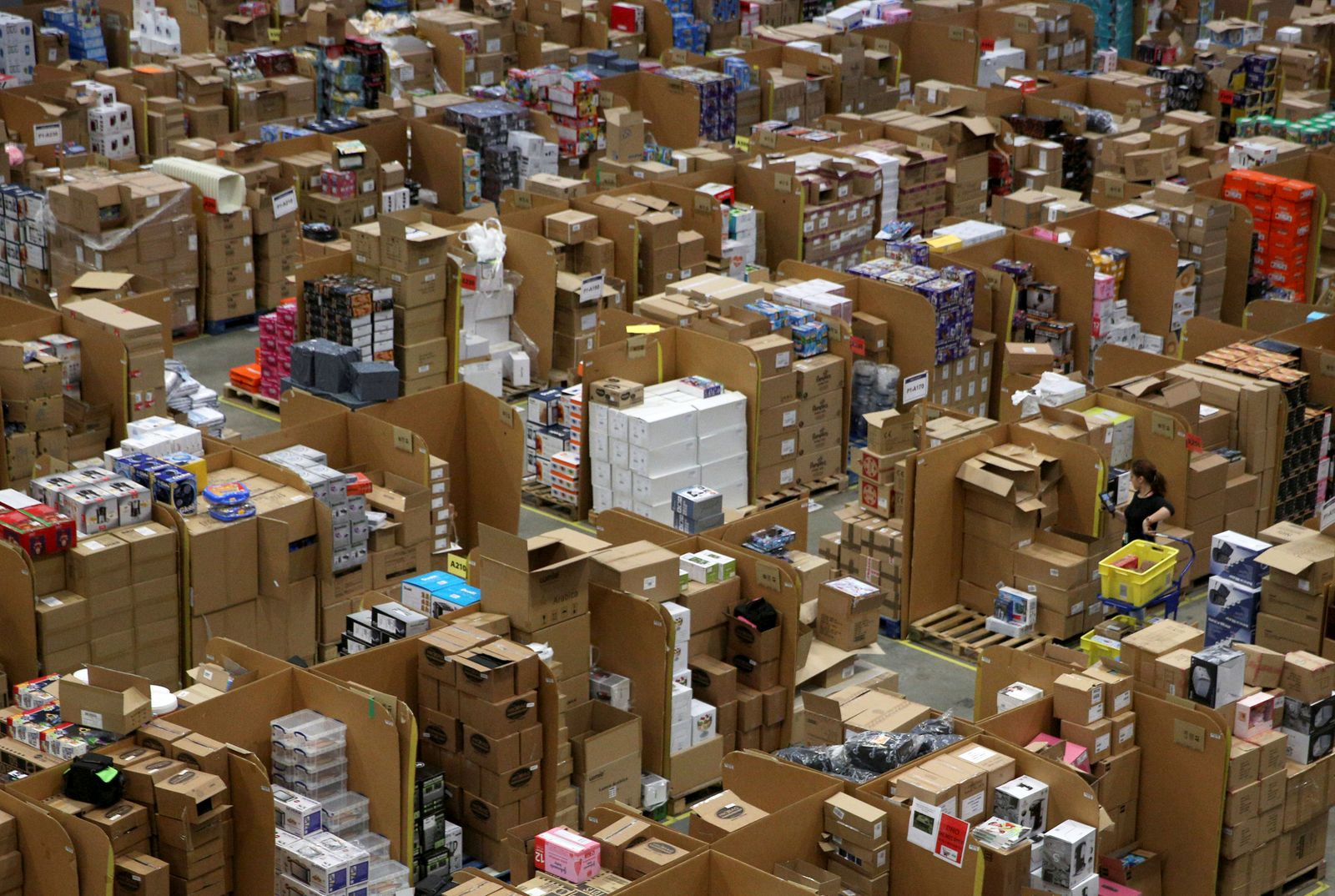 FILE PHOTO: Workers collect customer orders during Black Friday deals week at an Amazon fulfilment centre in Hemel Hempstead