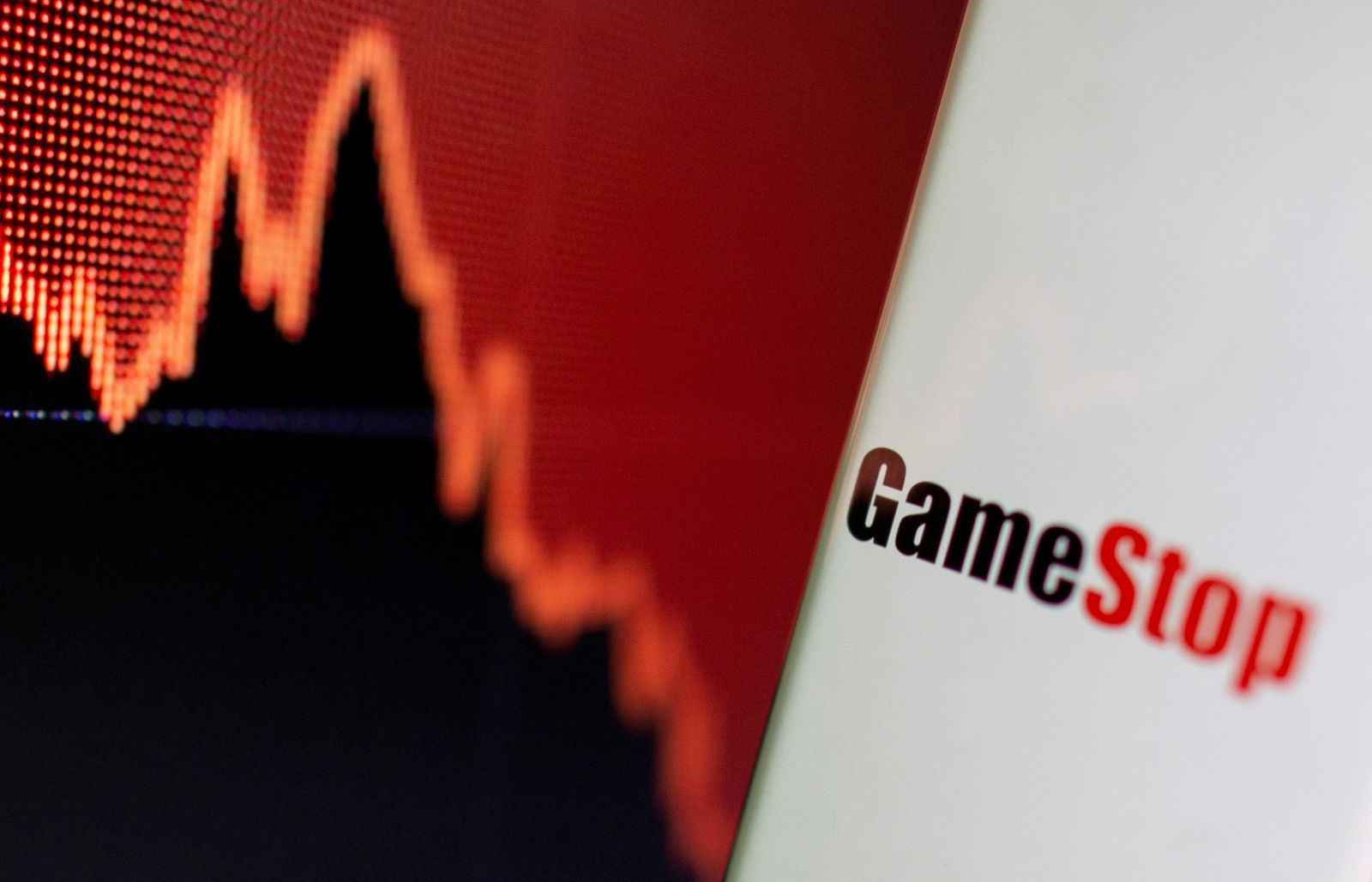 FILE PHOTO: GameStop logo is seen near displayed stock graph in this illustration