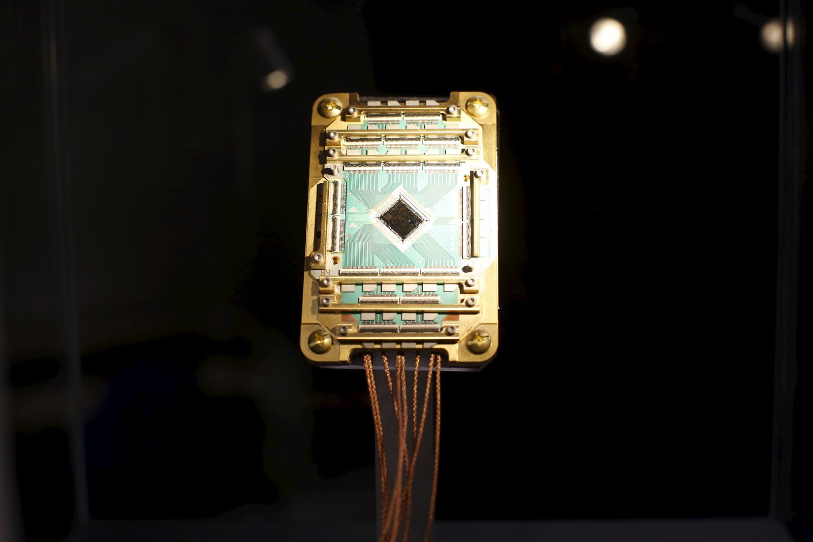 A D-Wave Vesuvius CPU Chip is pictured during a media tour of the Quantum Artificial Intelligence Laboratory (QuAIL) at NASA Ames Research Center in Mountain View, California