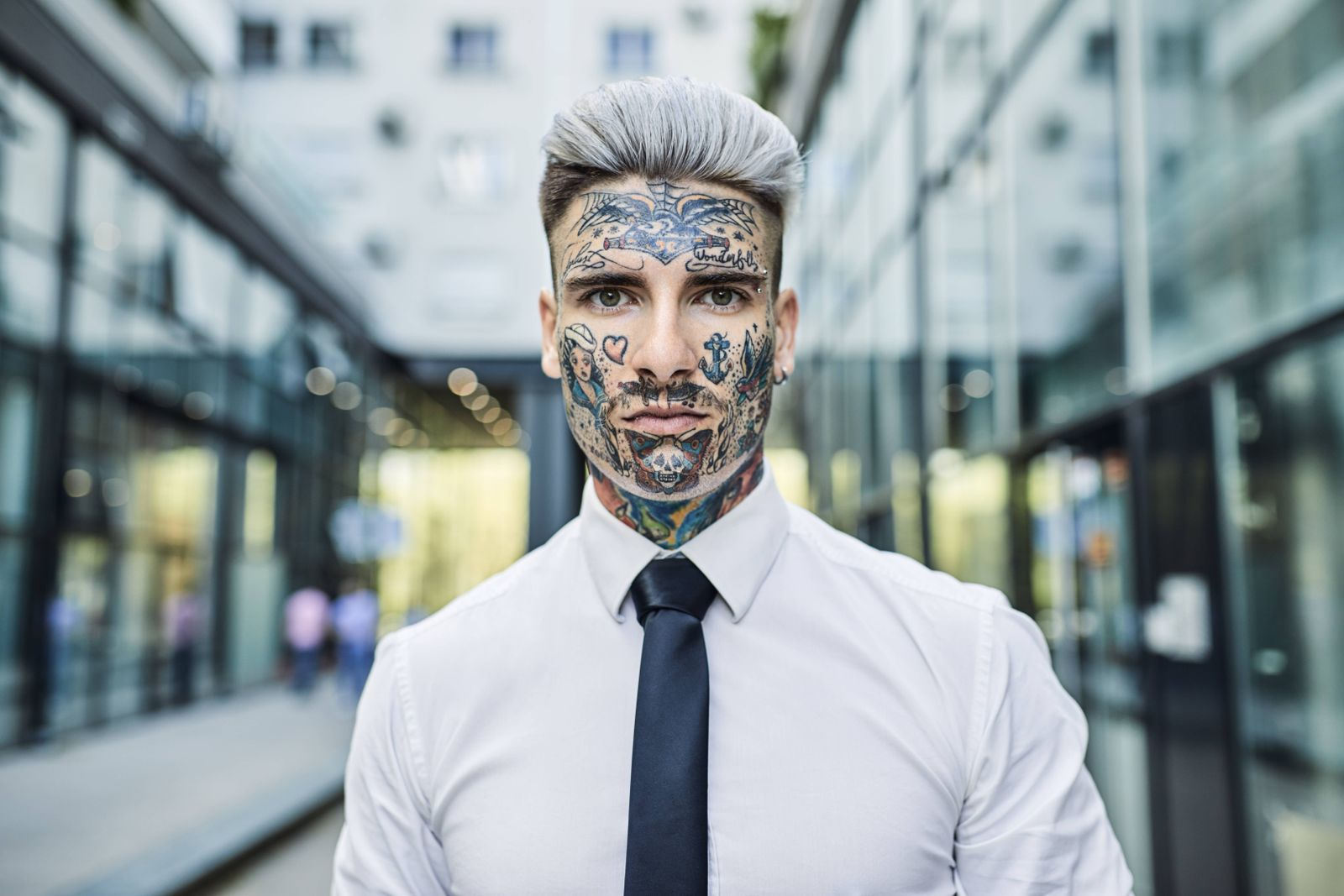 Young businessman with tattooed face portrait model released Symbolfoto property released PUBLICATI