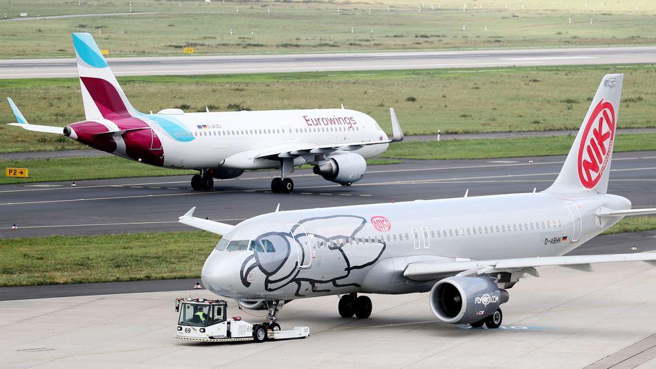 Nebeneinander und doch miteinander: Niki wird künftig mit einem Großteil seiner Maschinen Gäste der Lufthansa-Tochter Eurowings befördern