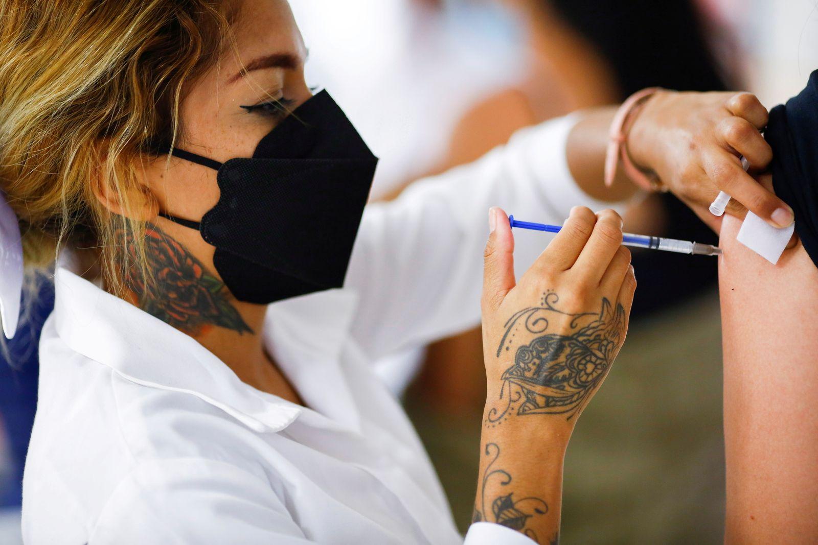 FILE PHOTO: Coronavirus disease (COVID-19) vaccination in Ciudad Juarez