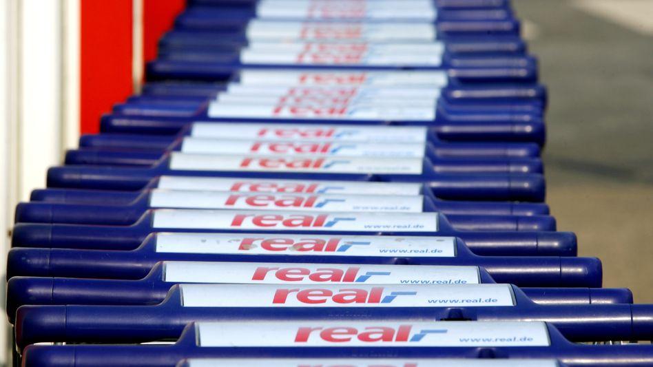 Real: Metro will die Supermarktkette Real lieber als Ganzes verkaufen