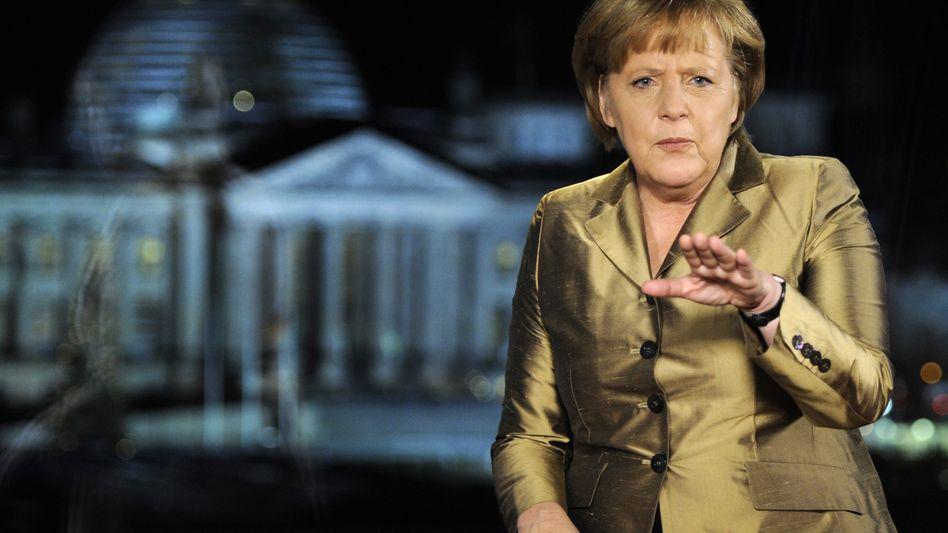 """Kanzlerin Angela Merkel nach der Aufnahme der Neujahrsansprache: """" 2012 wird schwieriger"""""""