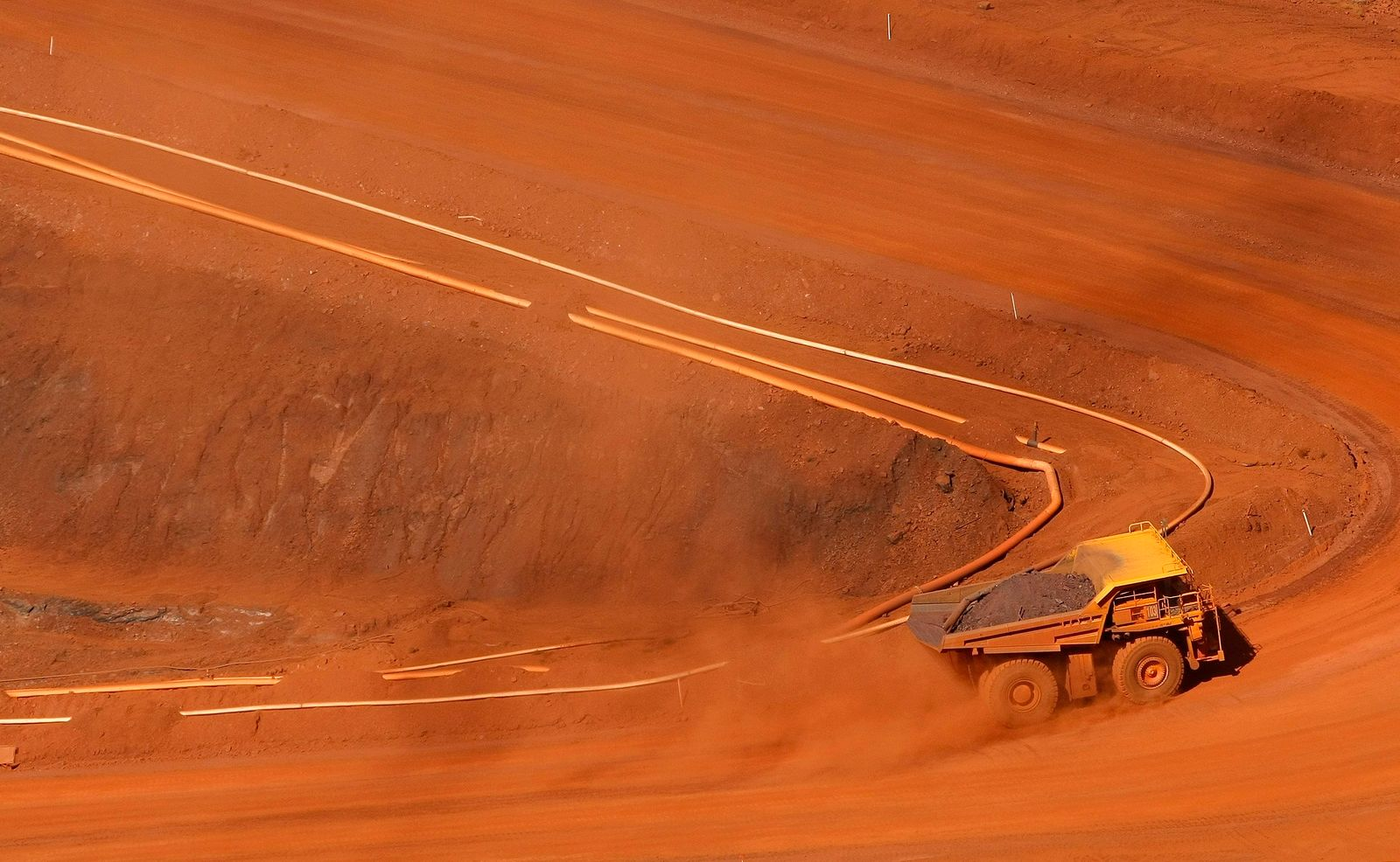 File photo of tipper truck climbing out of Rio Tinto iron ore mine at Tom Price