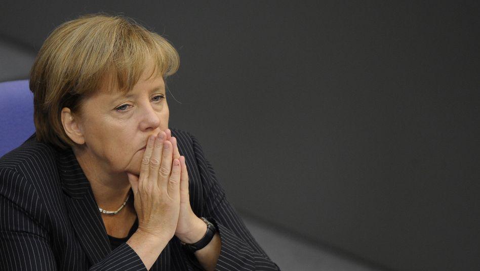Bundeskanzlerin Merkel: Muss um ihre Kanzlermehrheit bei der Abstimmung zur Ausweitung des Euro-Rettungsschirms bangen
