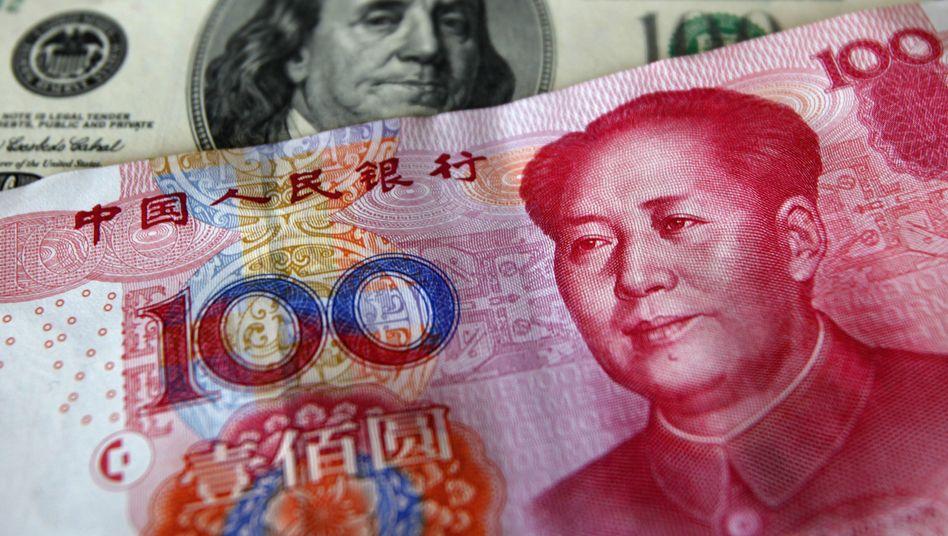 Feste Bindung: Die chinesische Währung Renminbi läuft im Gleichklang mit dem US-Dollar