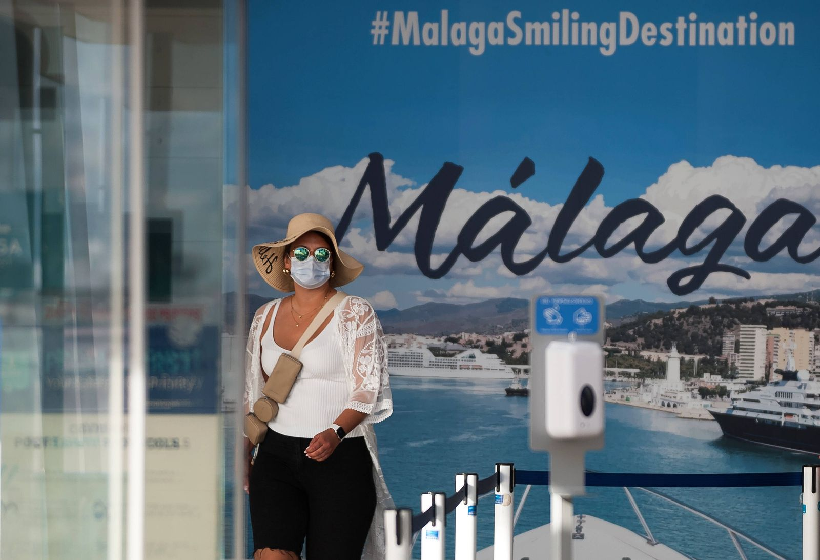 June 15, 2021, Malaga, Spain: A German tourist from the cruise ship seen next to an advertising panel at the port..The