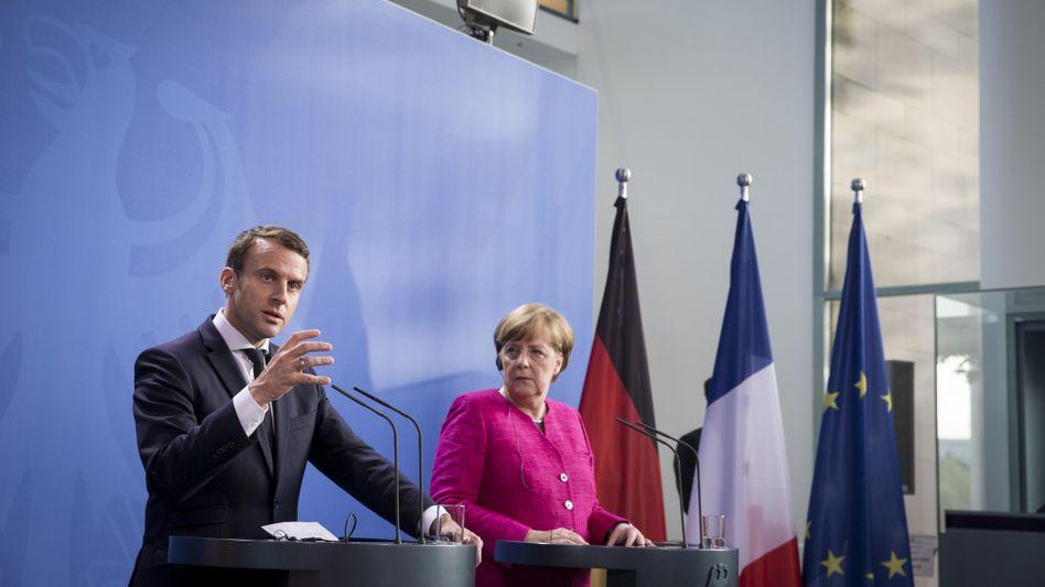 Frankreichs Präsident Macron mit Bundeskanzlerin Angela Merkel in Berlin: Wer ist wirklich der kranke Mann Europas?