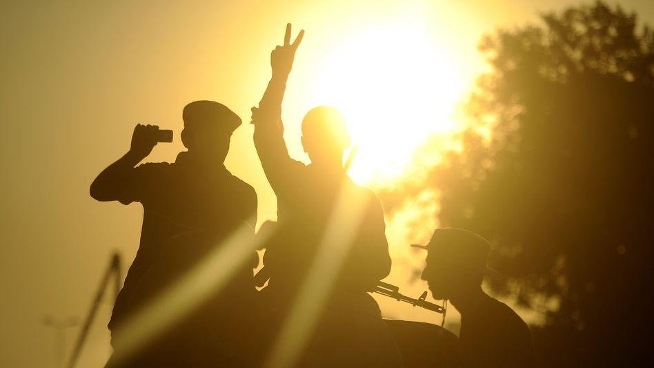 Siegessichere Rebellen in Libyens Hauptstadt Tripolis: Diktator Gaddafi will weiterkämpfen und ruft die Bevölkerung zum Widerstand auf